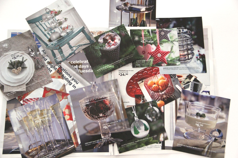 cutting out images from ikea christmas catalogue for upcycling project