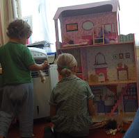 Top Ender being distracted and playing with a dolls house before School