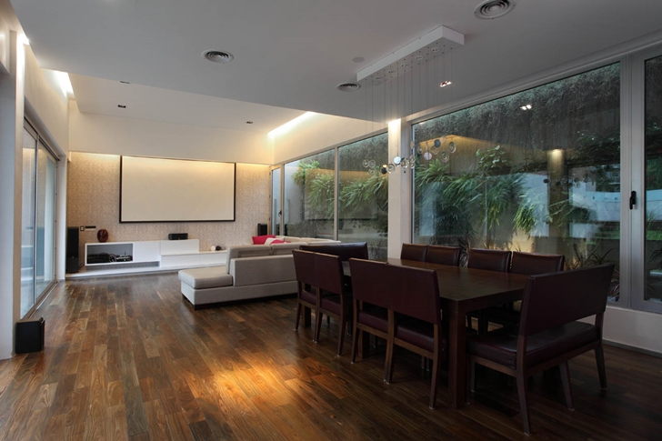 Dining and living room in Modern Villa Devoto by Andres Remy Architects