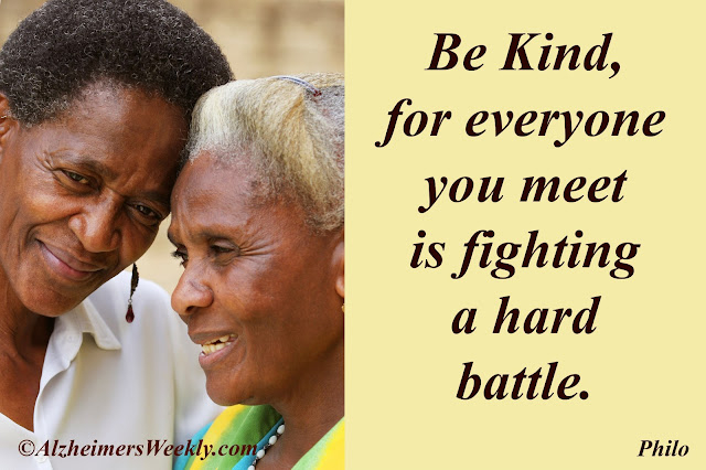 """Senior with caretaker and a saying: """"Be kind, for everyone you meet is fighting a hard battle. (Philo)"""""""