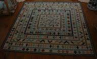 De antieke quilt - beter bekend in huis als de slingerrandjesdeken