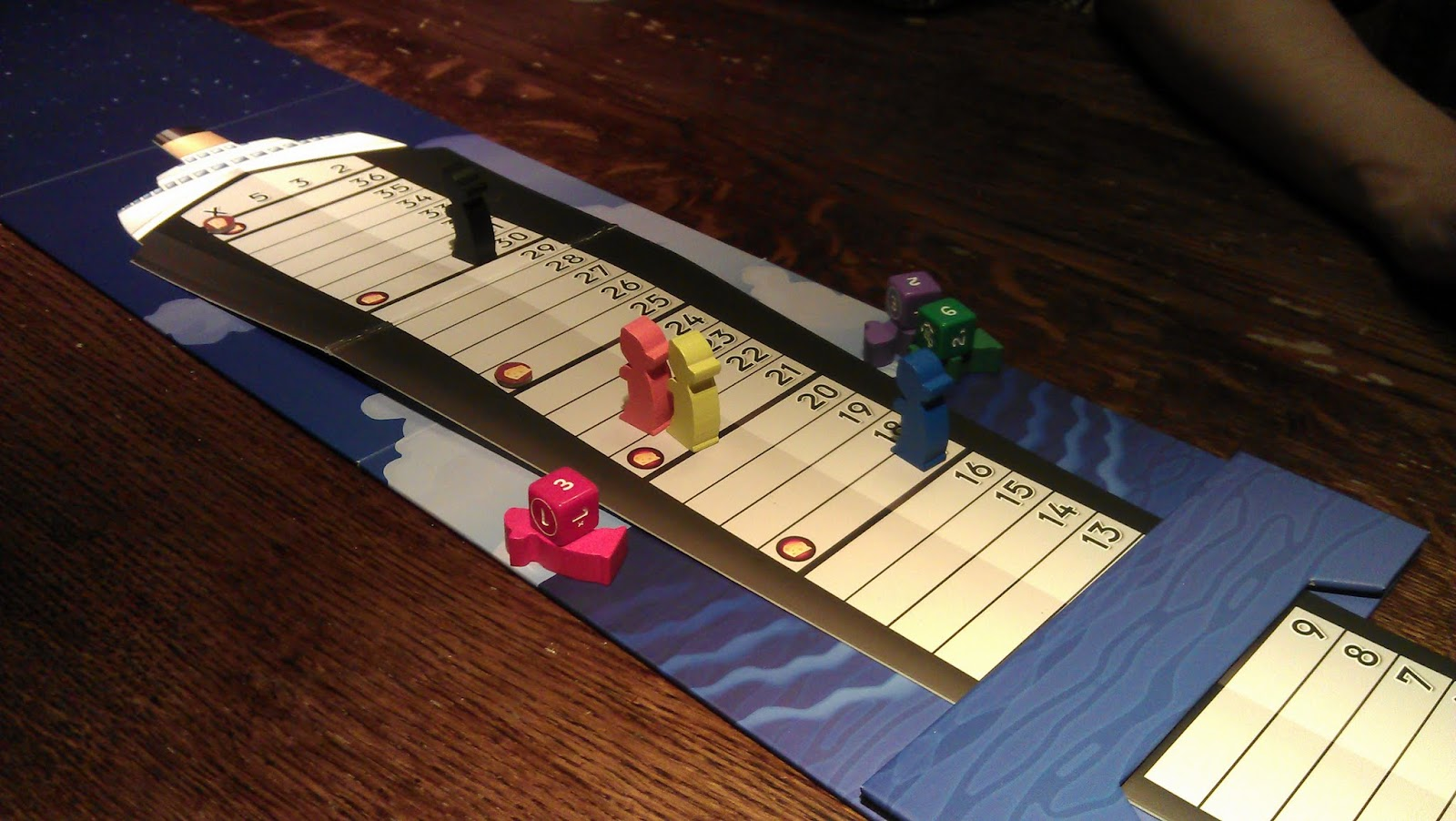 Abandon Ship - The surviving rats with the dead ones floating in the water with their dice!