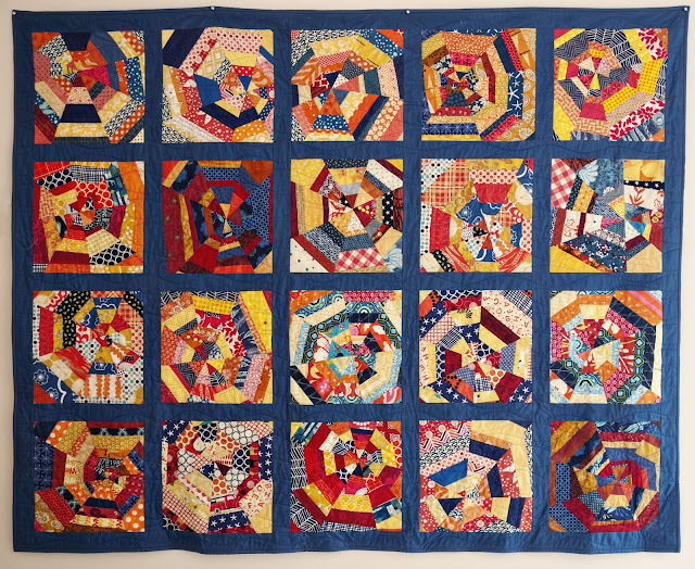 blue navy orange yellow spiderweb block quilt