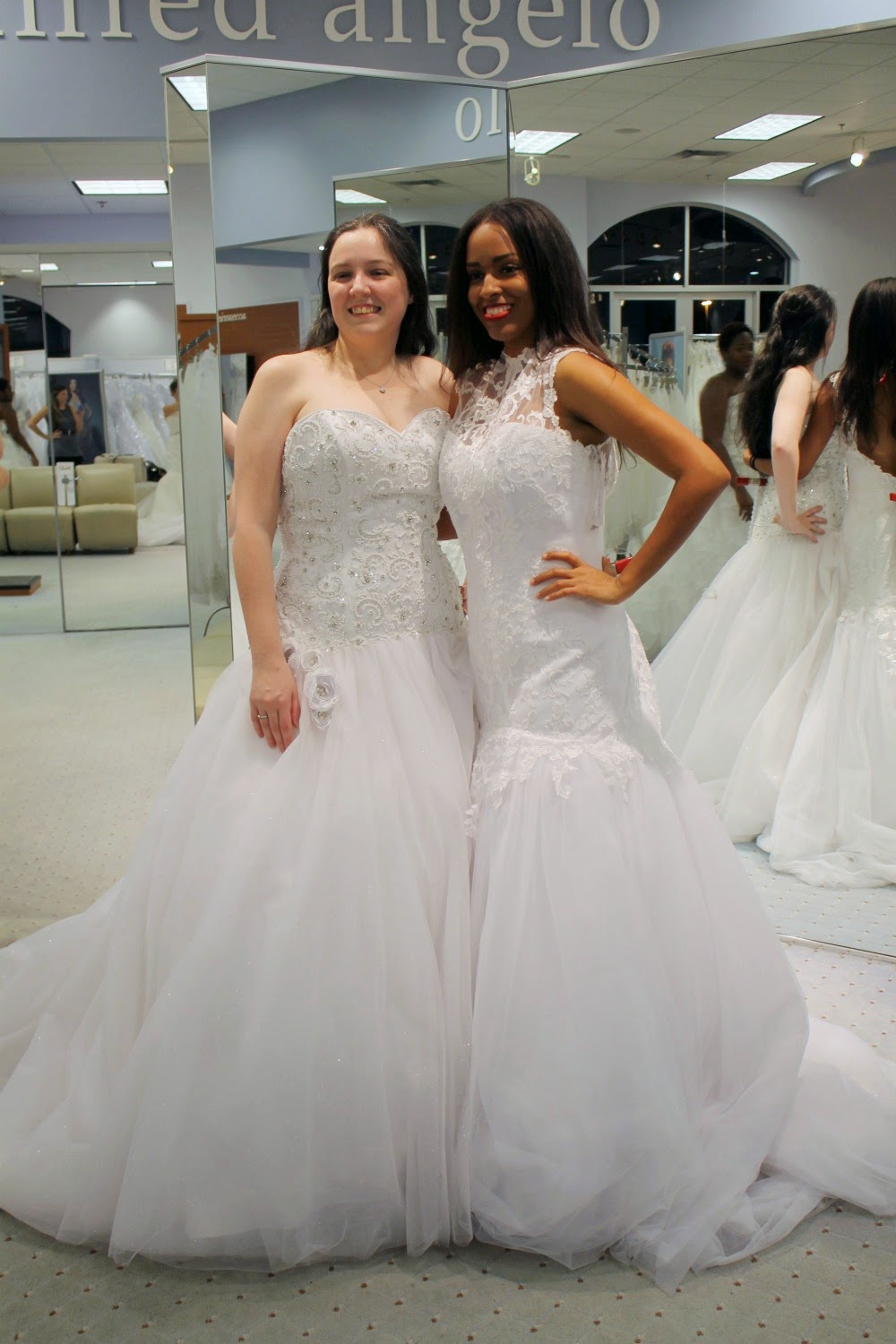 Tracie and Mina in wedding gowns