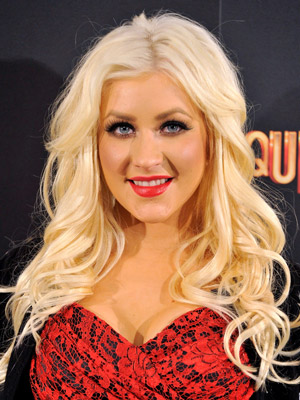 Christina Aguilera shows off her platinum locks with long, voluminous curls.
