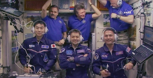 All six Expedition 44 crew members gathered inside the Zvezda service module for a crew greeting ceremony with new crewmates (front row from left) Kimiya Yui, Oleg Kononenko and Kjell Lindgren. In the back from left are Mikhail Kornienko, Gennady Padalka and Scott Kelly. Credit: NASA TV
