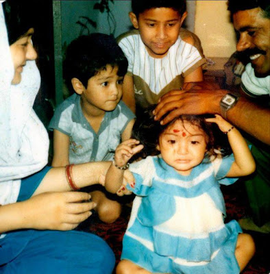 Anushka Childhood Photo with father and mother