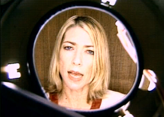 Kim Gordon, short blonde hair. Sonic Youth Still / screenshot from Little Trouble Girl (1995)