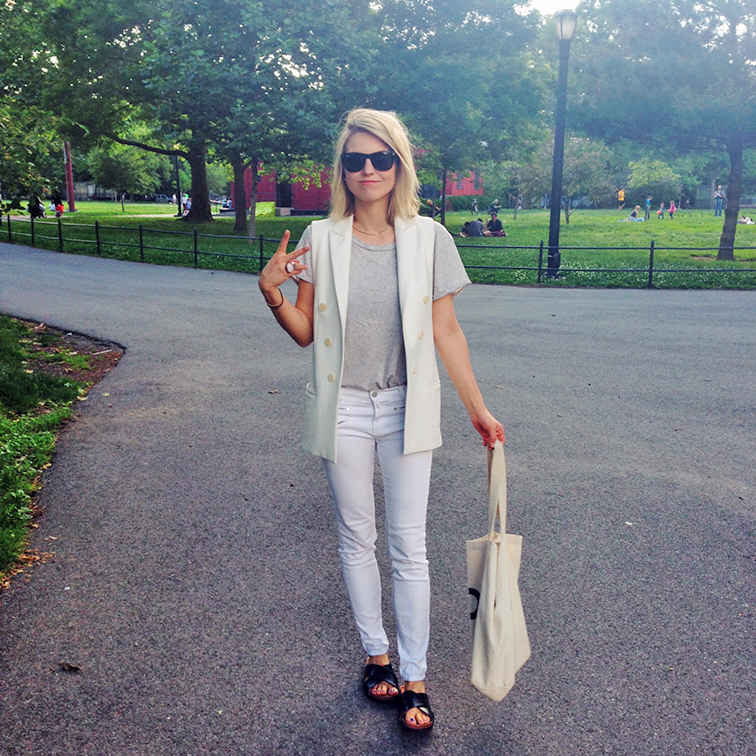 J Brand Jeans Zoe white denim, H&M crisscross cork slides, slip-on sandals, Zara white tuxedo vest, grey loose tee, Suburban riot canvas tote, Ray-Ban Wayfarers