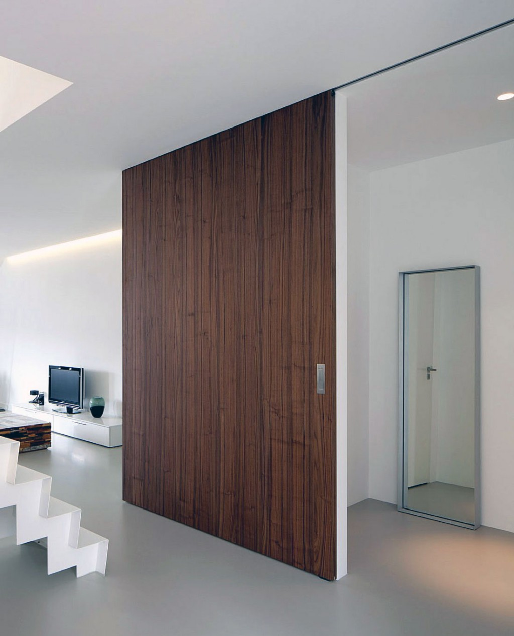 Saving space with slidings doors the grey home for Wooden sliding doors