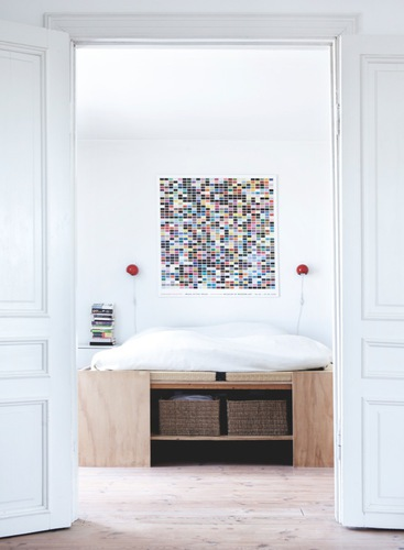 White modern Danish bedroom with raised bed