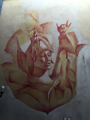 """Busto di Inge"" allo specchio, a mural inspired by Giacomo Manzù ""Busto di Inge"" bronzo. In the tiny courtyard in front of alvecchiotagliere.it."