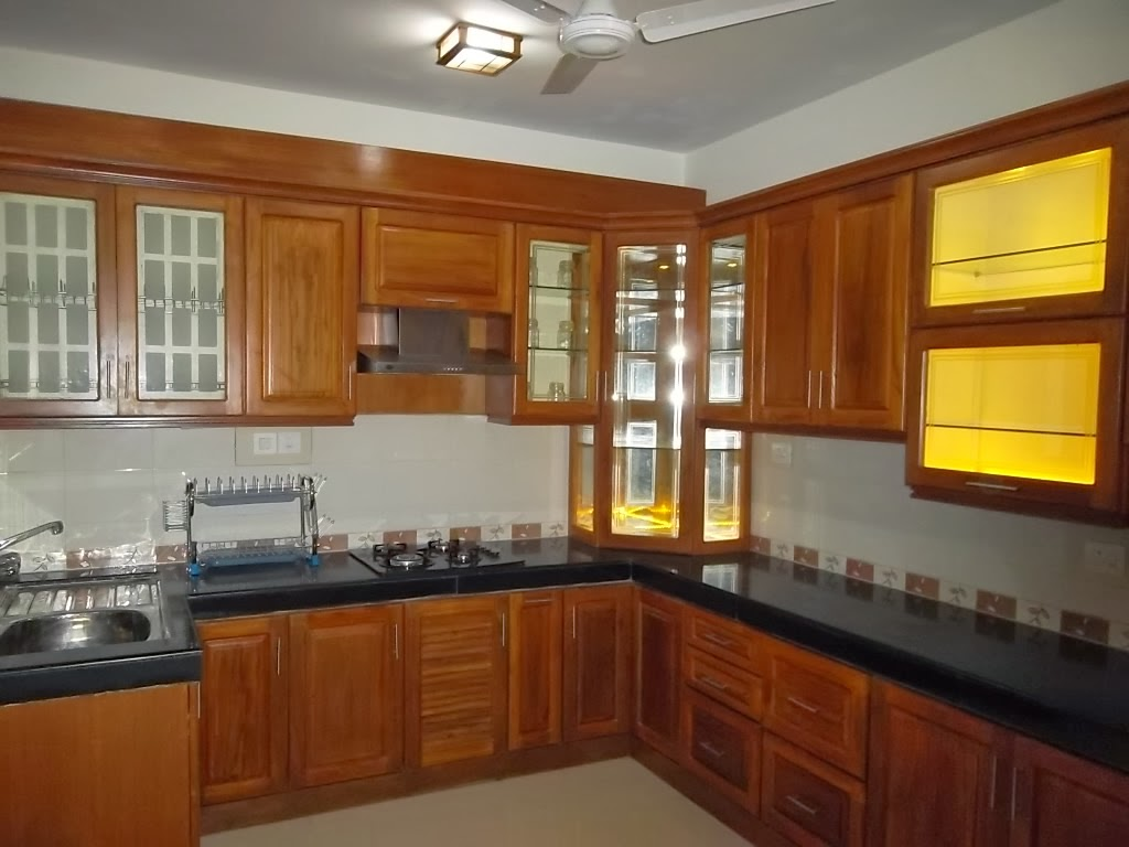 Construction of houses buildings on contract basis and on for Modern teak kitchen cabinets