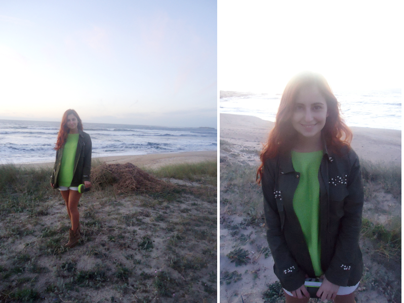 Outfit of a red haired girl in the beach with neon sweater, olive green jacket and camp clutch