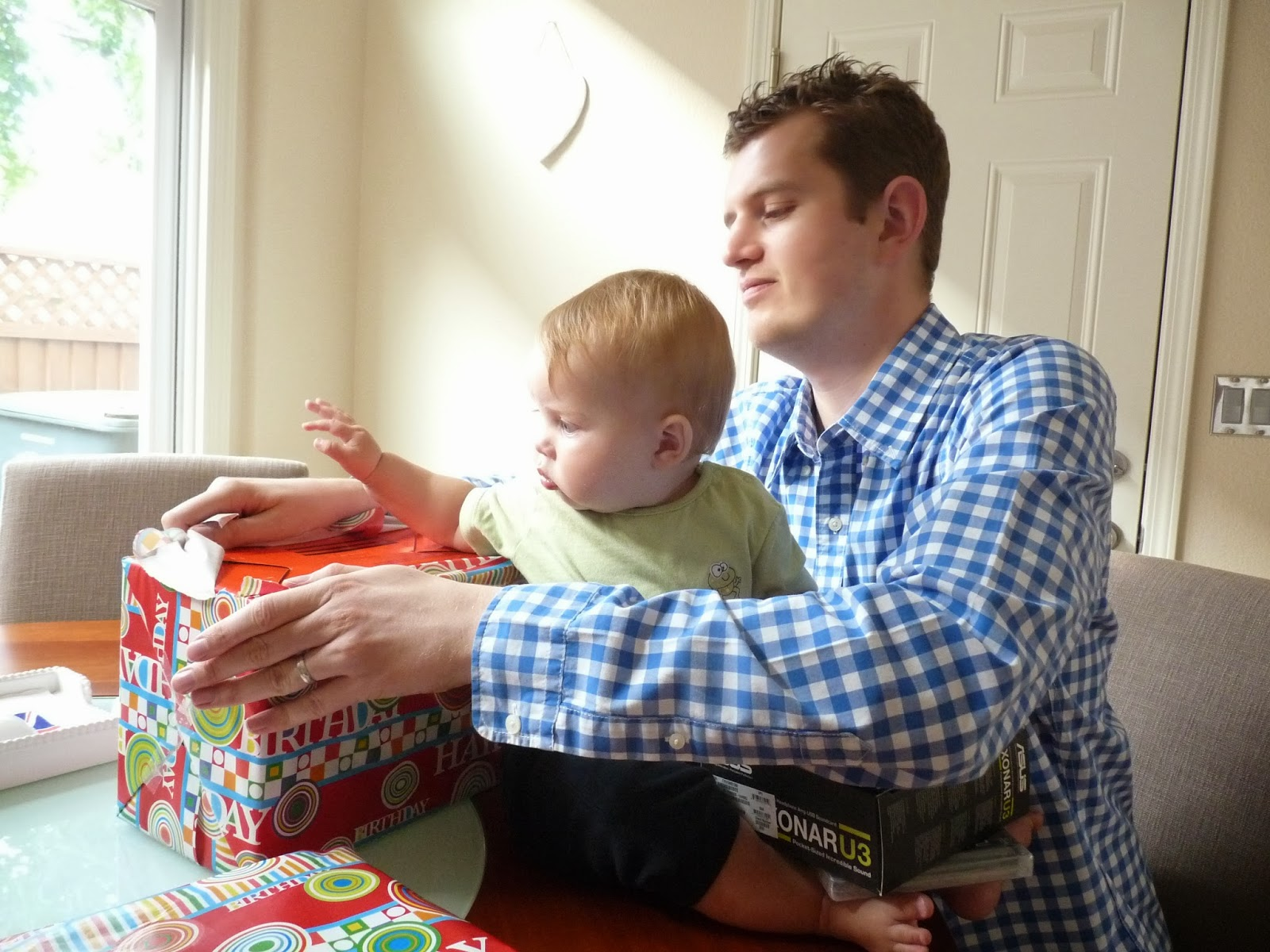 Freddie helps Daddy open his presents