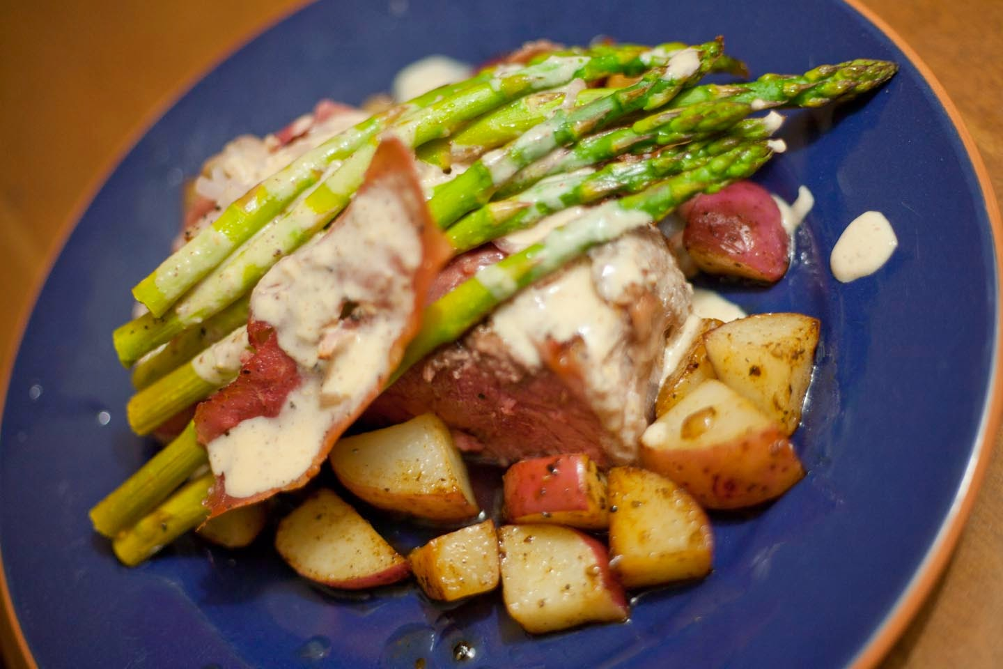 Red Potatoes That Appear To Be Cooked, Asparagus And  Shallots With What Looks To Be A Mustard Sauce And Prosciutto Or Some Other  Kind