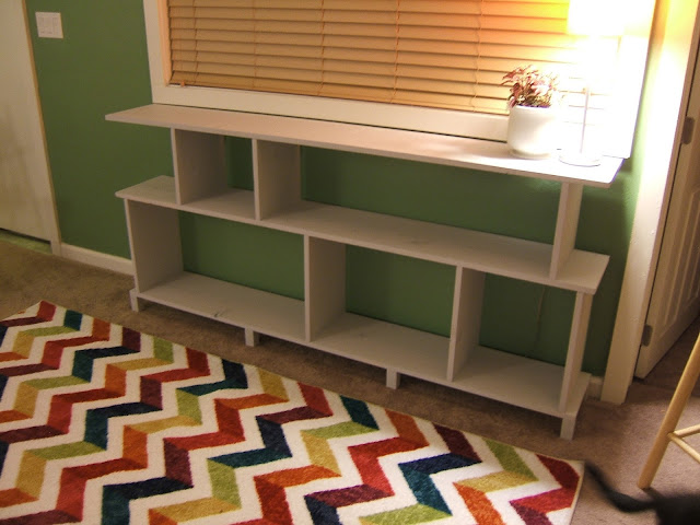 Get ready for picture palooza we put the shelf into place for Diy modern bookshelf