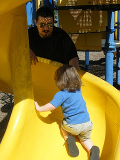 Daddy helping Sasha UP the slide