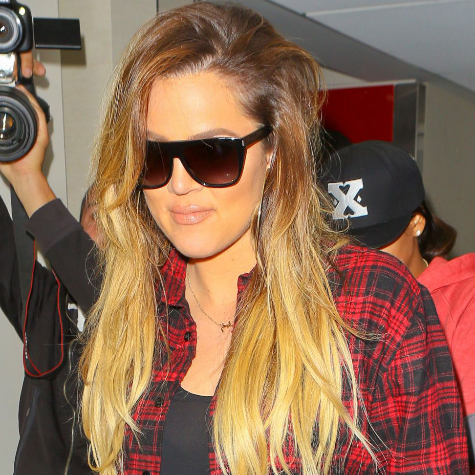 Khloe Kardashian wears an Arabic name necklace
