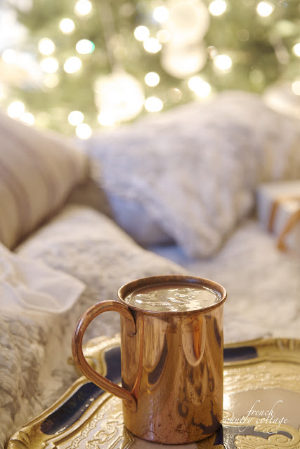 Christmas bedroom with hot cocoa on bed