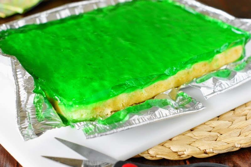 Cut the Margarita Cake-n-Jello Shots into cubes using a sawing motion ...