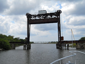 It only looks like a guillotine!  It's a railroad lift bridge.  Scary to go under!