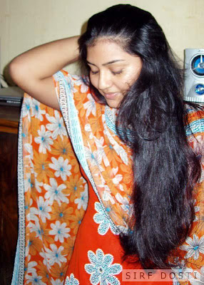 Gorgeous Kerala girl having thick hair grown as she uses coconut oil in food.