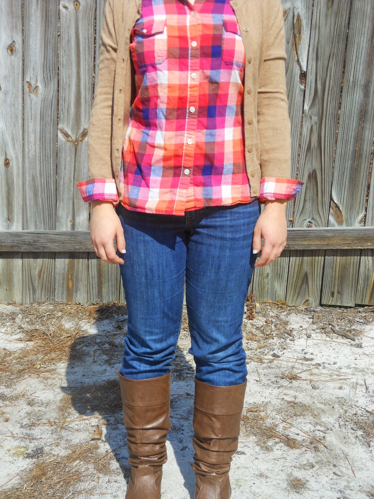 Plaid and Camel. Plaid button down, jeans, camel sweater, riding boots.