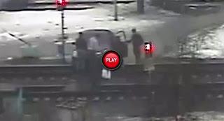 Moscow-Man-Tries-to-Drive-Nissan-Through-a-Train