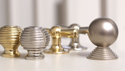 Cabinet fittings and door furniture