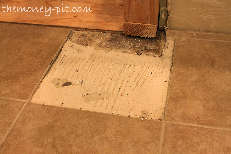 how to fix loose tile in shower floor