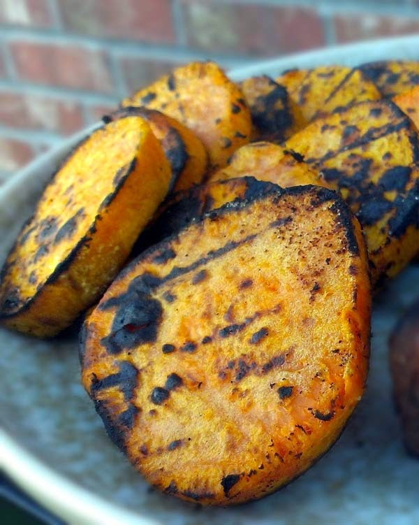 Grilled sweet potatoes seasoned with Tony Chachere's Original Creole Seasoning