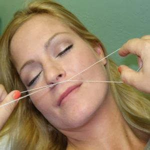 Hair-removing-Threading