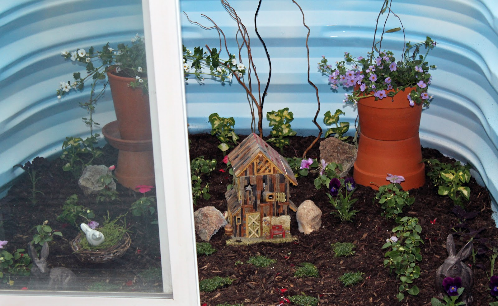 shannon 39 s shanonigins basement window well fairy garden