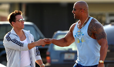 Mark Wahlberg and Dwayne Johnson star in PAIN & GAIN