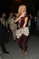 Rihanna waves to cameras and paparazzi