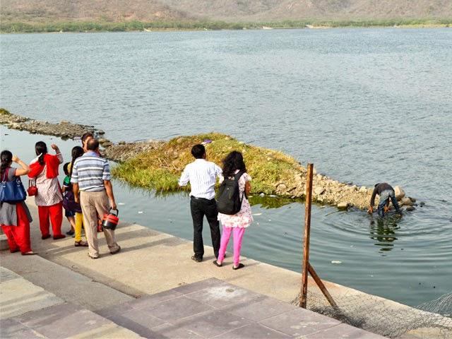 Family visiting looking Jal Mahal