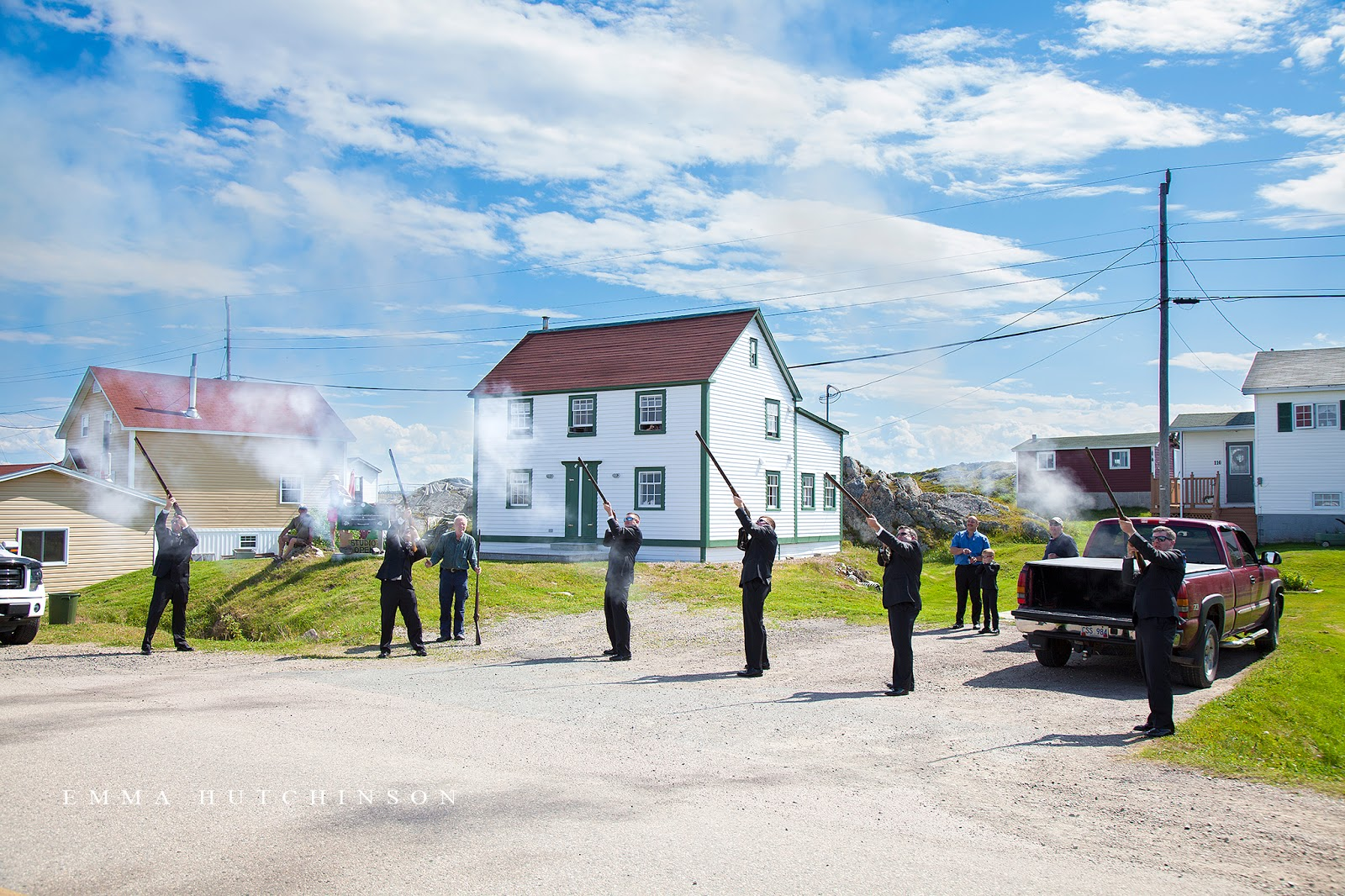 Weddings in Tilting, Fogo Island - The Groom shooting a gun after the Ceremony is a Tilting wedding tradition