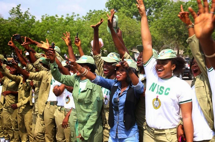 Members of the NYSC welcoming President Jonathan & the winning team to Lokoja