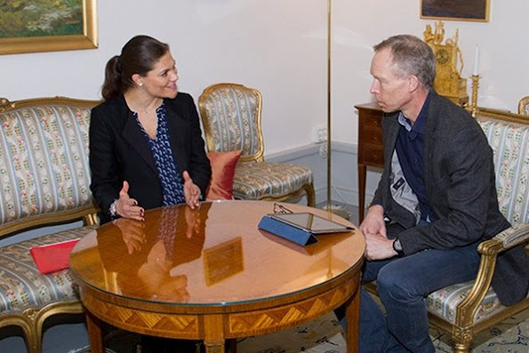 Crown Princess Victoria of Sweden met with Johan Fredrik Rockström who is a Professor of Environmental Science at Stockholm University, The Crown Princess wore BY MALENE BIRGER blacak Coat and MAYLA printed Dress