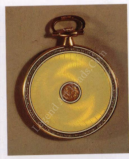 Above, a yellow gold dress watch, the back enameled opalescent oyster with a hint of flame over a wavy sunburst engraving, edged with rose diamonds within opaque white-enameled borders and, at the centre, an embossed dull green gold rosette on a granulated ground.