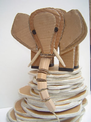 http://www.madeinslant.com/2011/06/alessandra-fiordaliso-upcycles-cardboard-into-creature-art/