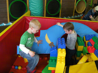 soft play area making a den with giant lego bricks