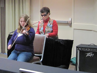 Brianna plays violin for Blessing