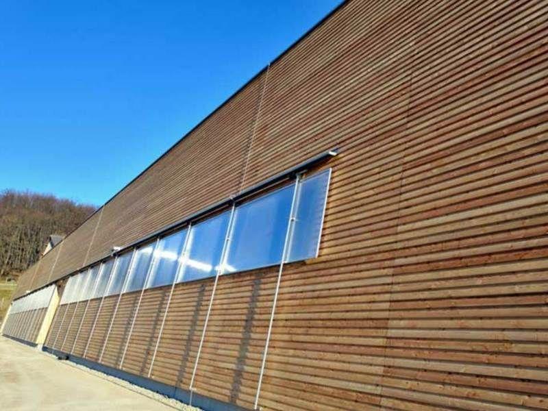 Revestimiento fachada imitacion madera materiales de - Paneles imitacion madera ...