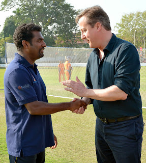 British Prime Minister David Cameron thanks Sri Lankan spin bowler Muttaiah Muralitharan (L) after trying his hand at batting during the former's visit to the Colombo Cricket Club in on November 16, 2013. Britain's Prime Minister David Cameron made a historic visit to Sri Lanka's former warzone, stealing the spotlight from a Commonwealth summit after the host, President Mahinda Rajapakse, warned against passing judgement on his country's past