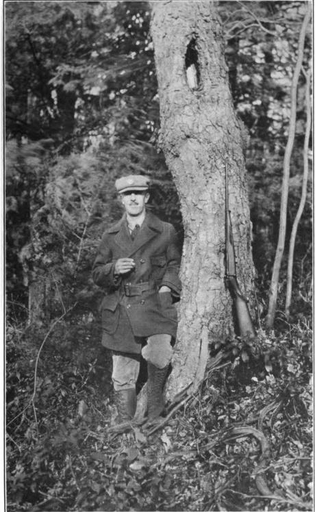 Arthur O. Friel with his gun
