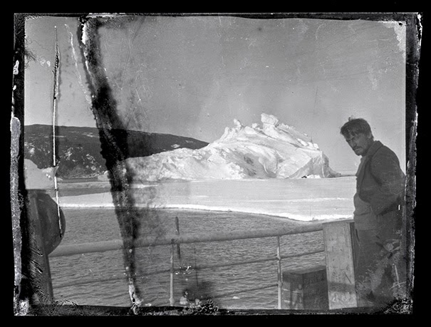 Alexander Stevens on Aurora deck, chief scientist and geologist. - 100-Year-Old Box Of Negatives Discovered Frozen In Block Of Antarctica's Ice