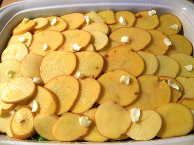 Top Layer of Potatoes in Casserole Dotted with Butter