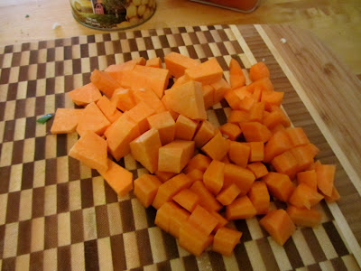 yams and carrots on a bamboo cutting board